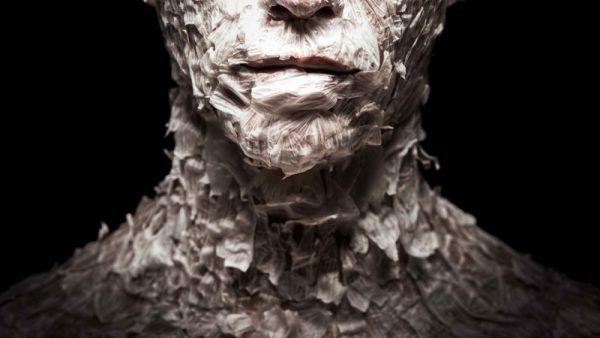 Fine art portrait of a person covered with garlic peel.